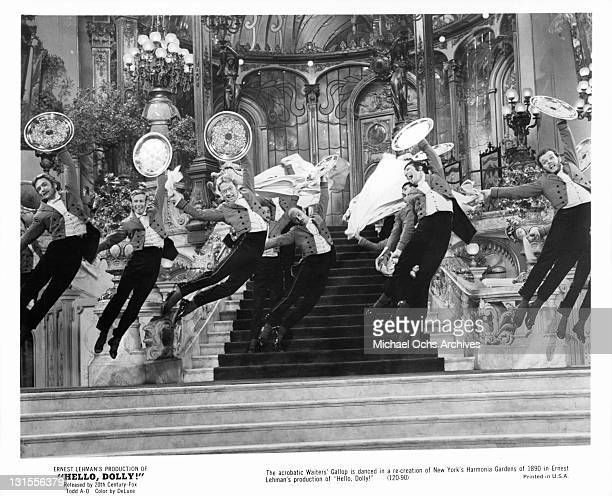 The acrobatic Waiters' Gallop is danced in a re-creation of New York's Harmonia Gardens of 1890 in a scene from the film 'Hello Dolly!', 1969.