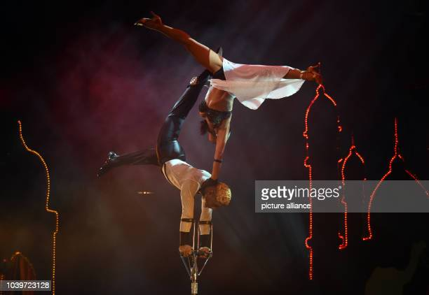 The acrobaticsduo 'The Liazeed' performs during the vaudevilleshow '1001 Nights in Marrakech' on stage of the Roncalli Apollo Vaudeville Theatre in...