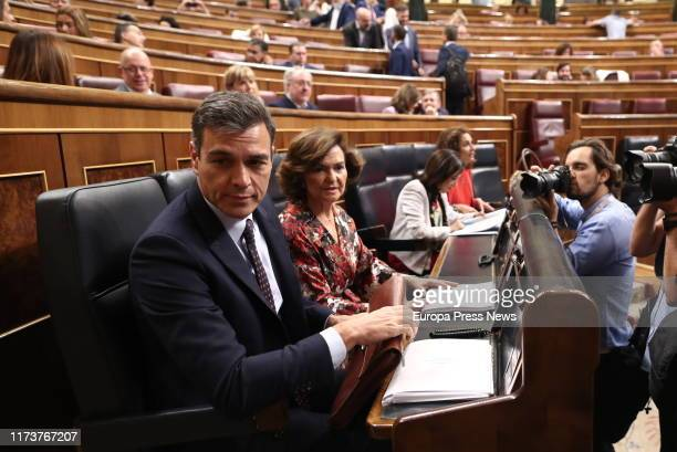 The acting president of the Government Pedro Sánchez and the vice president of the Government Carmen Calvo are seen before the speech of Sánchez to...