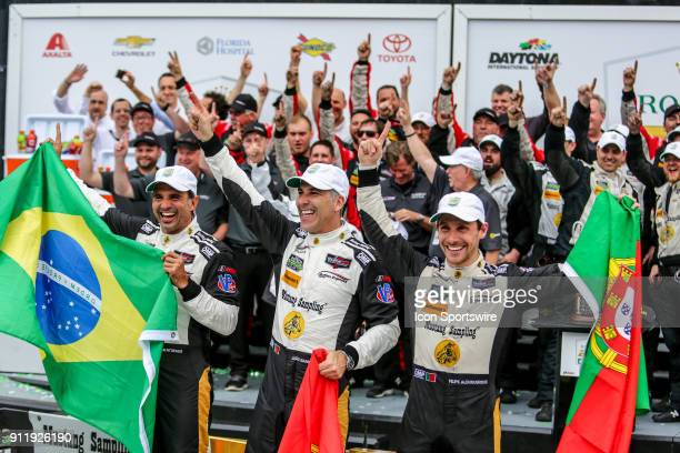 The Action Express Racing Cadillac DPiVR team of Filipe Albuquerque Joao Barbosa and Christian Fittipaldi celebrates in Victory Lane following the...