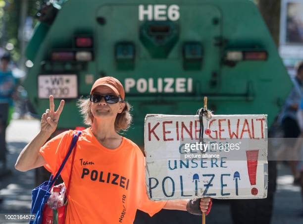 The activist Susann Zech speaks up for the protection of police officers with a sign in Frankfurt am Main Germany 24 June 2017 Photo Andreas...