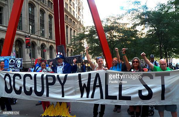 The activists bring banner and shout slogans as they gather during the 4th Anniversary of Occupy Wall Street. Occupy Wall Street is a cultural and...