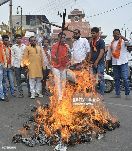 The activists from Bajrang Dal burn an effigy depicting Pakistan against the killing of 17 jawans in a terror attack on an army base in Uri in...