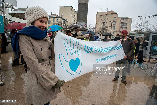 The activists of the group ' Alliance Vita ' form a human chain during a demonstration to protest against euthanasia on January 21 2015 in Lyon...