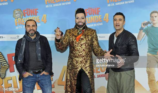 The actor Adnan Maral designer Harald Gloeoeckler and actor Mehmet Kurtulus pose at the premiere of the movie 'Fuenf Freunde 4' at the Cinemaxx movie...