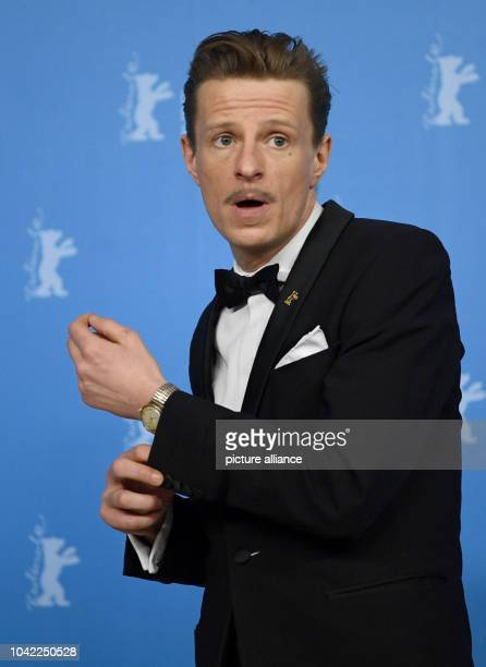 The actor Alexander Scheer arrives for the photo call of the film 'The Young Karl Marx' at the 67th International film festival in Berlin Germany 12...