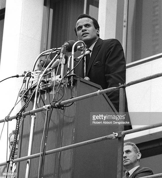 The actor and Civil Rights activist Harry Belafonte addresses the crowd during a rally following the memorial march in tribute for the slain Dr...