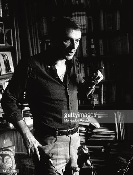The actor and director Giorgio Albertazzi is photopraphed while he is talking and gesticulating in the studio of his house in Rome. Rome, 1966.