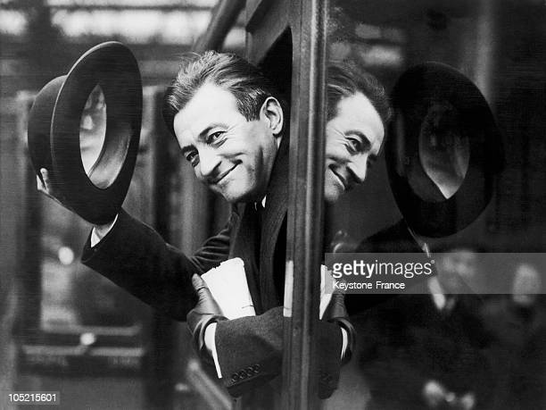 The Actor Claude Rains Saluting From The Window Of His Compartiement Before The Train That Carries Him To The United States In March 1935