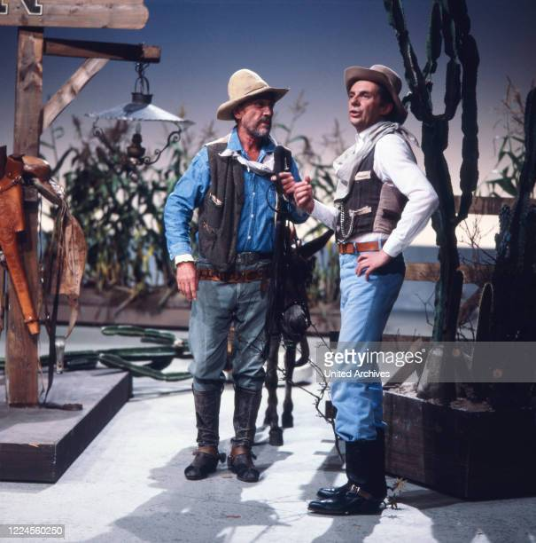 The actor entertainer and voice actor Harald Juhnke dressed as a cowboy during a performance or sketch with Ken Curtis from the TV series Gunsmoke...