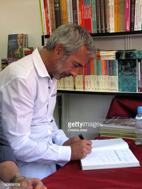 """The actor Imanol Arias signed the book of the TV show about food and travel """"A country to eat"""", Madrid Book Fair, Spain, June 2011."""