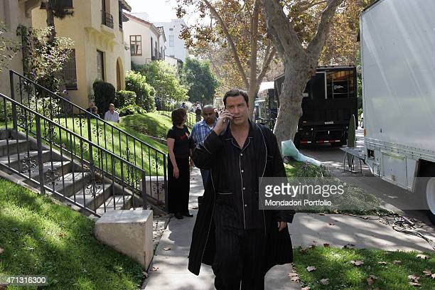 The actor John Travolta being photo shooted on the set in Los Angeles where the Sky TV commercials for the Italian broadcast service are being...