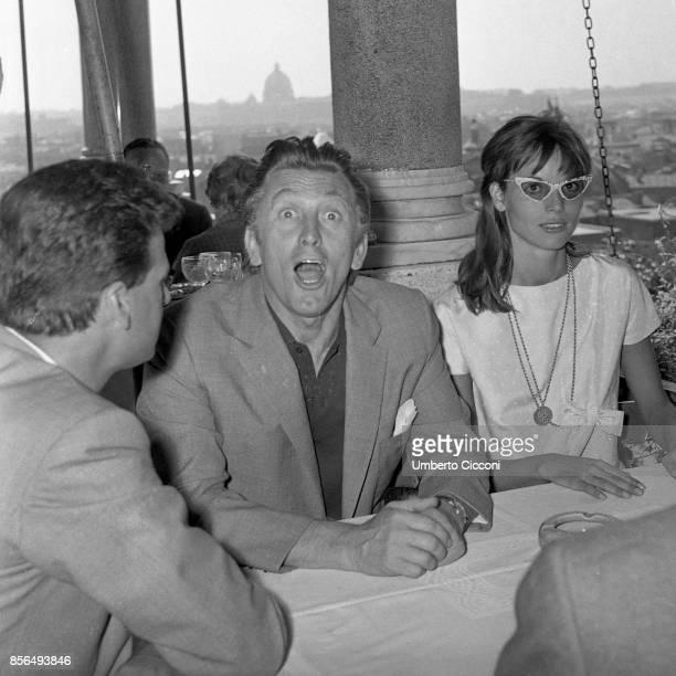The actor Kirk Douglas is with the actress and model Elsa Martinelli at 'Casina Valadier' in Rome 1958 He is making a funny expression in this photo