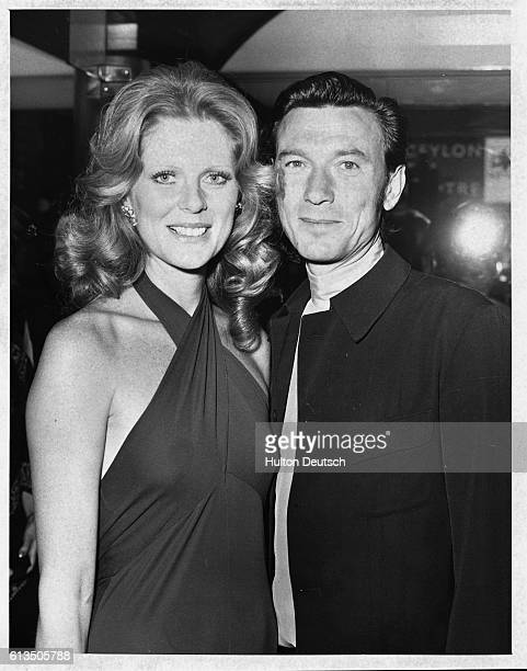 The actor Laurence Harvey arrives at the cinema in London for the premiere of the The Godfather with his companion the model Pauline Stone 1972