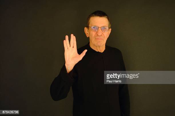 The actor Leonard Nimoy makes the Vulcan hand greeting at his home March 2, 2002 in Bel Air, Los Angeles, California.
