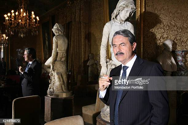 The actor Massimo Dapporto being photo shooted while smoking at Palazzo Pretorio the town hall of Palermo and set for the TV film Giovanni Falcone...