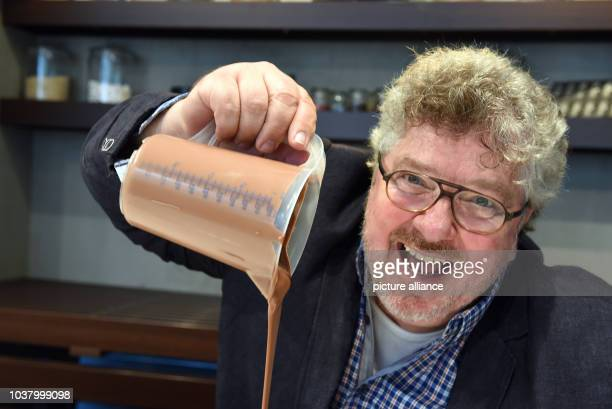 EXKLUSIVE The actor Michael Schanze pouring chocolate into heart mold from a measuring cup at the chocolate museum in Cologne Germany 17 October 2016...