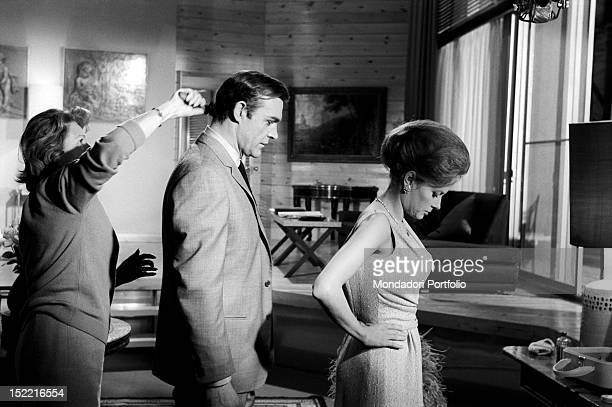 The actor Sean Connery gets his hair fixed while the actress Luciana Paluzzi focuses on before shooting a scene from Thunderball fourth episode of...