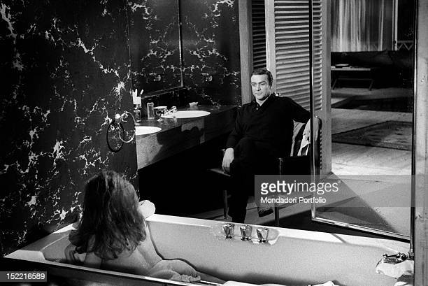 The actor Sean Connery gives the actress Luciana Paluzzi an adoring look while she is in the bathtub on the set of the movie Thunderball by Terence...