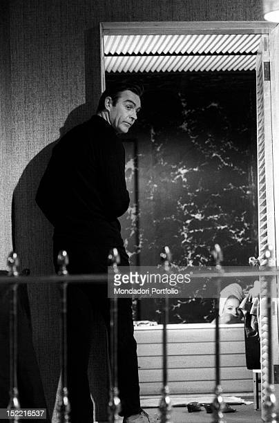 The actor Sean Connery on the set of Thunderball, fourth episode of secret agent 007's series, prepares himself to shoot a scene with Luciana...