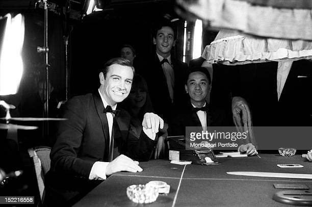 The actor Sean Connery smiles at a photographer during a break in the shooting of a scene at the casino from the movie Thunderball fourth episode of...