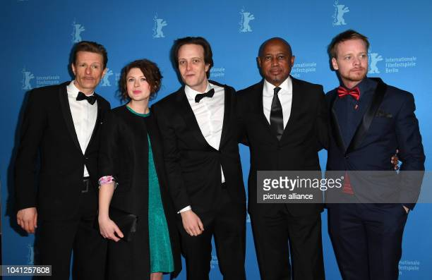 The actors Alexander Scheer Hannah Steele August Diehl director Raoul Peck and actor Stefan Konarske arrive for the photo call of the film 'The Young...