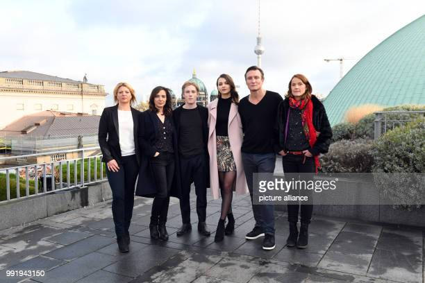 The actors and actresses Joerdis Triebel Maja Schoene Louis Hofmann Lisa Vicari Oliver Masucci and Karoline Eichhorn stand beside each other during a...