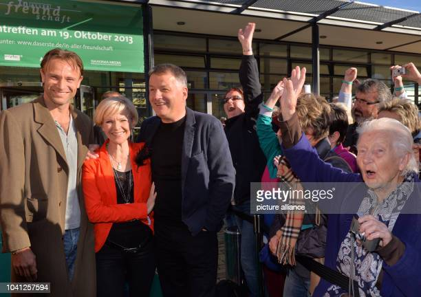 The actors Bernhard Bettermann Andrea Kathrin Loewig and Thomas Ruehmann open the fan festival of the ARD television series 'In aller Freundschaft'...