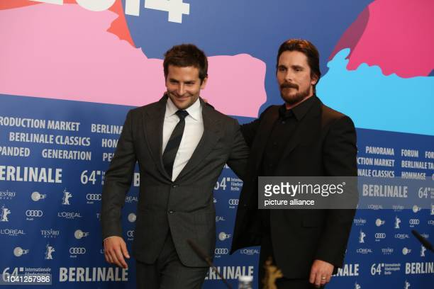 The actors Bradley Cooper and Christian Bale attends the press conference for 'American Hustle' during the 64th annual Berlin Film Festival in Berlin...