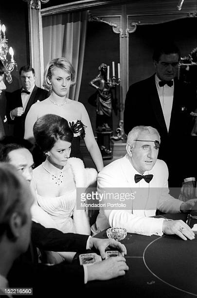The actors Claudine Auger and Adolfo Celi in a scene at the casino from Thunderball fourth episode of secret agent 007's series Pinewood march 1965