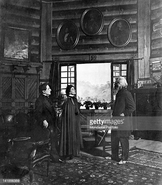 The actors Eleonora Duse Ciro Galvani and Agostino Borgato acting in a scene from the drama 'Rosmersholm' 1906