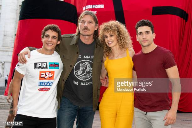 The actors Esther Acebo Jaime Lorente Luka Peroš and Miguel Herrán attend to the presentation of the third season of Money Heist in Piazza Affari on...