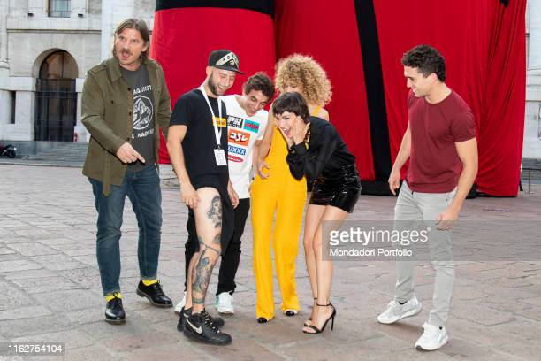 The actors Esther Acebo Jaime Lorente Luka Peroš Miguel Herrán and Úrsula Corberó with a fan attend to the presentation of the third season of Money...