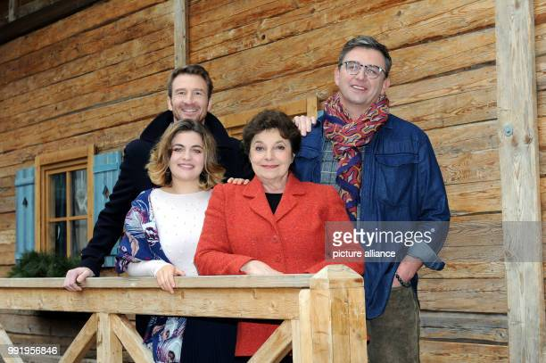 The actors Heiko Ruprecht Ronja Forcher Monika Baumgartner and Hans Sigl smile during the press tour 'Zehn Jahre und 100 Folgen Der Bergdoktor' at...