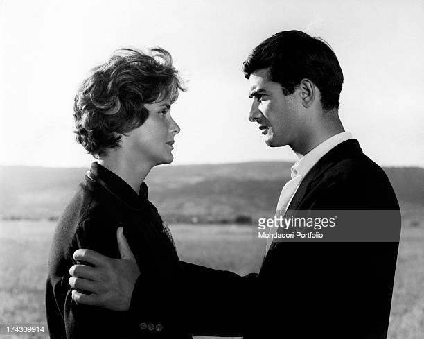 The actors JeanClaude Brialy and Alida Valli playing the leading roles of Jacky and Agathe two former lovers look intensely at each other's eyes...