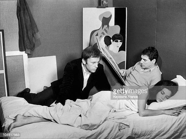 The actors JeanLouis Trintignant Robert HOSSEIN and Florinda Bolkan in a scene from the film' LE VOLEUR DE CRIMES' directed by Nadine Trintignant in...