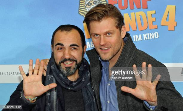 The actors Jens Atzhorn and Adnan Maral pose at the premiere of the movie 'Fuenf Freunde 4' at the Cinemaxx movie theater in Munich Germany 25...