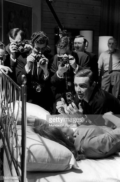 """The actors Sean Connery and Luciana Paluzzi are besieged by photographers during the shooting of a hot scene from """"Thunderball"""", fourth episode of..."""