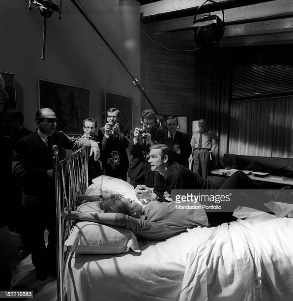 The actors Sean Connery and Luciana Paluzzi besieged by photographers during the shooting of a hot scene from the movie Thunderball, fourth episode...
