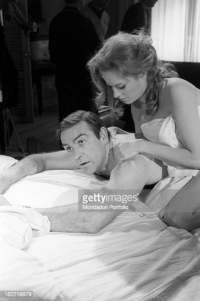 The actors Sean Connery and Luciana Paluzzi in bed are preparing themselves to shoot a hot scene from the movie Thunderball fourth episode of secret...