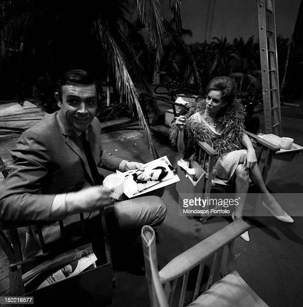 The actors Sean Connery and Luciana Paluzzi relax themselves during a break on the set of Thunderball fourth episode of secret agent 007's series...