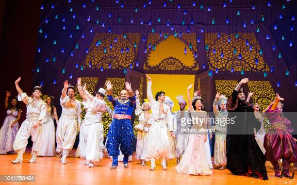 The actors stand on stage at the Theater Neue Flora during the premiere of the Disney musical 'Aladdin' in Hamburg Germany 06 December 2015...