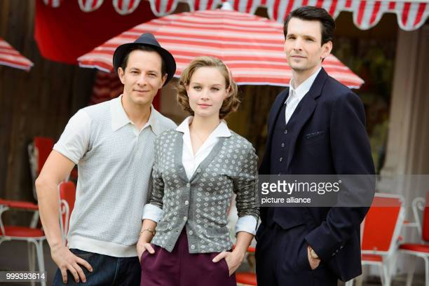 The actors Trystan Puetter Sonja Gerhardt and Sabin Tambrea are posing for a group portrait at the film set of the TVseries 'Ku'damm 59' in Berlin...