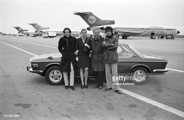 The actors Ulli Lommel, Katrin Schaake, Werner Schwier and Michael Stueck on the airfield of Munich Riem airport, Germany, 1960s.