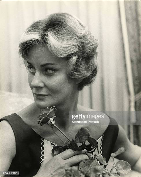 The actress Alida Valli with a rose in her hand at her birthday party May 31 1961