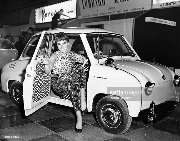 The actress and novelist Jackie Collins models a Leopard skin outfit seated in the Goggomobil T300 family four seater car at the Earl's Court Motor...