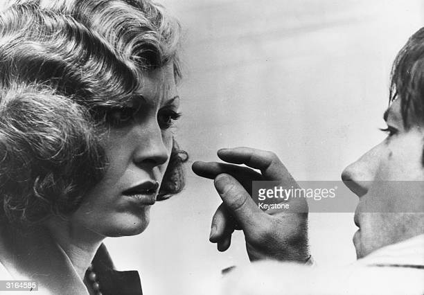 The actress Faye Dunaway taking instructions from director Roman Polanski on the set of 'Chinatown'