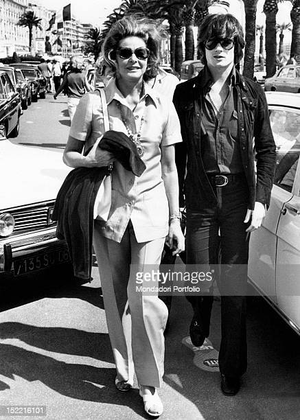 The actress Ingrid Bergman walking along the road with her son Roberto Jr known as Robertino Cannes 1973