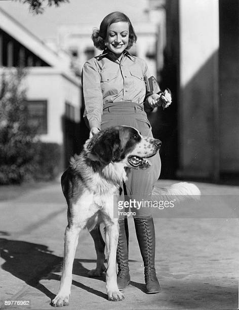 The actress Joan Crawfors with her dog Photograph Around 1935