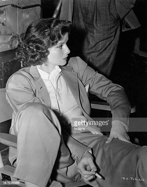 The actress Katharine Hepburn sitting dresses in suit Photograph About 1938 Die Schauspielerin Katharine Hepburn sitzend im Anzug Photographie Um 1938